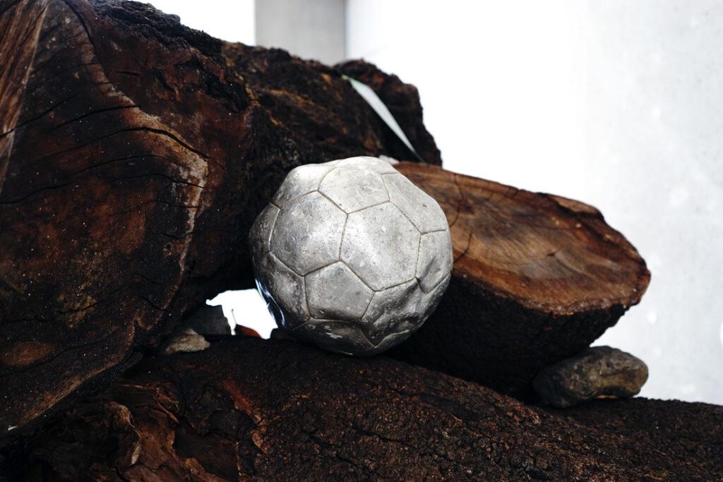 Kicking balls on the globe installation view 3